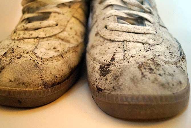 Dreckiges und nicht festes Schuhwerk